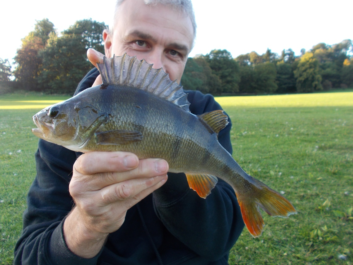 Posing with a stillwater perch