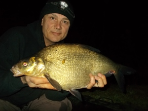 Posing with a pit bream