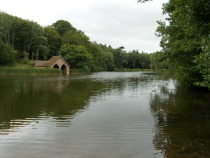 A traditional estate lake with a boathouse