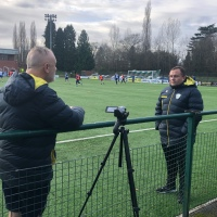 As The Players Trained At Park Hall, Chatting With John Rhodes, TNS FC's Head Of Recruitment